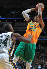 Memphis Grizzlies forward Rudy Gay (22) shoots over Utah Jazz forward Paul Millsap (24) in the second half of an NBA basketball game on Sunday, Feb. 12, 2012, in Memphis, Tenn.  Gay led the scoring for the Grizzlies with 22 points.  The Jazz defeated the Grizzlies 98-88. (AP Photo/Nikki Boertman)