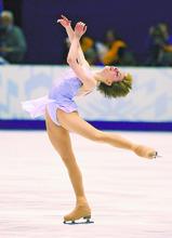 Sarah Hughes skates her way ato a Gold medalin the Ladies's figure skating finals at the Salt Lake Ice Center. Michelle Kwan placed third behind Irina Slutskaya of Russia.  photo by Rick Egan  02-21-2002
