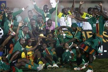 Zambia's players and team staff celebrate with the African Cup of Nations trophy after beating Ivory Coast in their final soccer match at Stade de l'Amitie in Libreville, Gabon Sunday, Feb. 12, 2012. (AP Photo/Rebecca Blackwell)
