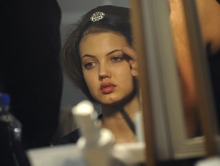 A model is made up backstage before the showing of the Oscar de la Renta Fall 2012 collection during Fashion Week, Tuesday, Feb. 14, 2012, in New York.  (AP Photo/Louis Lanzano)