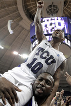TCU's Hank Thorns (10) is carried off the court by Cheick Kone, bottom, following their NCAA college basketball game against UNLV on Tuesday, Feb. 14, 2012, in Fort Worth, Texas. Thorns led scoring with 32-points in the 102-97 win over UNLV. (AP Photo/Tony Gutierrez)