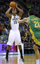 Utah Jazz shooting guard Raja Bell (19) shoots the ball over New Orleans Hornets point guard Greivis Vasquez (21) in the first half of an NBA basketball game in New Orleans, Monday, Feb. 13, 2012. (AP Photo/Jonathan Bachman)