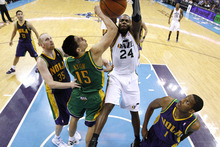 Utah Jazz power forward Paul Millsap (24) dunks the ball over New Orleans Hornets power forward Gustavo Ayon (15) in the second half of an NBA basketball game in New Orleans, Monday, Feb. 13, 2012. The Hornets won their fifth game this season 86-80.(AP Photo/Jonathan Bachman)