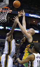 New Orleans Hornets center Chris Kaman (35) scores over Utah Jazz center Al Jefferson, left, in the second half of an NBA basketball game in New Orleans, Monday, Feb. 13, 2012. The Hornets won their fifth game this season 86-80. Chris Kaman led the Hornets with 27 points. (AP Photo/Jonathan Bachman)