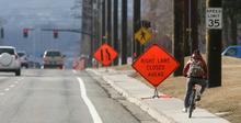 Steve Griffin  |  The Salt Lake Tribune  A biker rides on the sidewalk on Sunnyside Avenue in Salt Lake City on Wednesday.  Salt Lake City has delayed plans for a