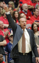 Utah head coach Larry Krystkowiak signals his team as they play Arizona during the first half of an NCAA college basketball game at McKale Center in Tucson, Ariz., Saturday, Feb. 11, 2012. (AP Photo/John Miller)