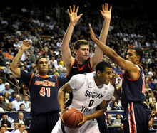 James Roh  |  AP photo/The Daily Herald BYU's Brandon Davies defends the ball from Pepperdine players during the second half of game at the Marriott Center in Provo Saturday. BYU rolled over Pepperdine, 86-48.