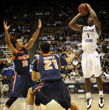 BYU's Charles Abouo (1) goes up for a basket during the first half of an NCAA college basketball game against Pepperdine at the Marriott Center in Provo, Utah, Saturday, Feb. 11, 2012. (AP Photo/The Daily Herald, James Roh)  MANDATORY CREDIT