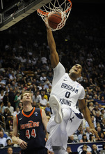 BYU's Brandon Davies (0) slam dunks the ball during the second half of an NCAA college basketball game against Pepperdine at the Marriott Center in Provo, Utah, Saturday, Feb. 11, 2012. (AP Photo/The Daily Herald, James Roh)  MANDATORY CREDIT MANDATORY CREDIT