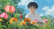 Human boy Shawn (right, voice of David Henrie) is astonished when he visits the garden and discovers Arrietty (voice of Bridgit Mendler) a tiny person who lives hidden with her family under the floorboards of the house where he's staying, in Disney's release of the Studio Ghibli animated feature,