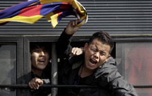 Tibetan exiles shout slogans from inside a police vehicle after being detained during a protest outside the Chinese Embassy in New Delhi, India, Thursday, Feb. 16, 2012. Upcoming Tibetan New Year's celebrations appear poised to bring more bloodshed to the troubled Himalayan region, the head of Tibet's exile government Lobsang Sangay said Tuesday, warning that China has sealed off the regions ahead of a crackdown. He said festivals around the Feb. 22 Tibetan New Year, as well as the March 10 anniversary of the failed 1959 uprising, are very likely to bring Tibetans into the streets. (AP Photo/Manish Swarup)