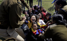 Indian police detain Tibetan exiles during a protest outside the Chinese Embassy in New Delhi, India, Thursday, Feb. 16, 2012. Upcoming Tibetan New Year's celebrations appear poised to bring more bloodshed to the troubled Himalayan region, the head of Tibet's exile government Lobsang Sangay said Tuesday, warning that China has sealed off the regions ahead of a crackdown. He said festivals around the Feb. 22 Tibetan New Year, as well as the March 10 anniversary of the failed 1959 uprising, are very likely to bring Tibetans into the streets. (AP Photo/Manish Swarup)