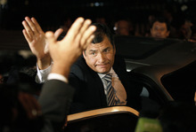 Ecuador's President Rafael Correa greets supporters outside the National Court of Justice building in Quito, Ecuador, early Thursday, Feb. 16, 2012.  Ecuador's highest court upheld early Thurday a criminal libel verdict favoring  Correa, including three-year prison terms for three executives and a columnist of the opposition newspaper El Universo, and a total of $42 million in damages.. (AP Photo/Dolores Ochoa)