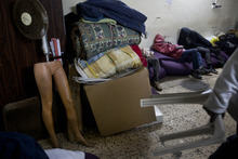 African refugees keep themselves warm at a shelter in Tel Aviv, Israel Thursday, Feb. 16, 2012. Some 50,000 Africans have entered Israel in recent years, fleeing conflict and poverty in search of safety and opportunity in the relatively prosperous Jewish state. A growing number of African migrants say they were captured, held hostage and tortured by Egyptian smugglers hired to sneak them into Israel.(AP Photo/Oded Balilty)