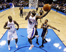 Oklahoma City Thunder guard James Harden (13) shoots in front of center Nazr Mohammed (8) and Utah Jazz guard Earl Watson, right, in the first quarter of an NBA basketball game in Oklahoma City, Tuesday, Feb. 14, 2012. Harden contributed 22 points as Oklahoma City won 111-85. (AP Photo/Sue Ogrocki)