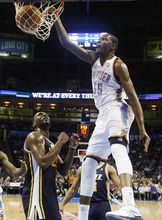 Oklahoma City Thunder forward Kevin Durant (35) dunks in front of Utah Jazz center Al Jefferson, left, in the third quarter of an NBA basketball game in Oklahoma City, Tuesday, Feb. 14, 2012. Oklahoma City won 111-85. (AP Photo/Sue Ogrocki)