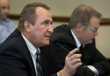 Scott Sommerdorf  |  The Salt Lake Tribune              Attorney General Mark Shurtleff testifies against SB157, sponsored by Sen. Stephen Urquhart, R-St. George, right. The measure, proposing to repeal Utah's guest-worker law, was shot down in the committee on a motion from Senate President Michael Waddoups.