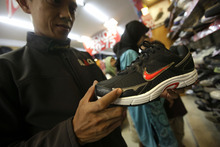 Dita Alangkara  |  The Associated Press Under the concept of StoryBranding, Nike products are popular not only because of how they look and feel, but for the bond of their association with the value of athletic achievement.