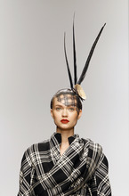A model displays a creation by designer Corrie Nielsen during a fashion show at London Fashion Week, Friday, Feb. 17, 2012. (AP Photo/Kirsty Wigglesworth)