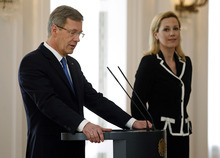 German President Christian Wulff, left, announces his resignation during a statement at the Bellevue Palace in Berlin, Germany, Friday, Feb. 17, 2012. At right is his wife  Bettina Wulff. German President Christian Wulff resigned Friday in a scandal over favors he allegedly received before becoming head of state - creating a new problem for Chancellor Angela Merkel. Wulff announced his immediate resignation a day after the slow-burning affair escalated dramatically with a request by prosecutors for Parliament to lift his immunity from prosecution.(AP Photo/Michael Sohn)