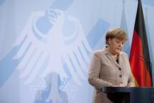 German Chancellor Angela Merkel briefs the media after President Christian Wulff stepped down in Berlin Friday, Feb. 17, 2012. (AP Photo/Markus Schreiber)