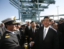 Chinese Vice President Xi Jinping , right, shakes hands with officers as he tours China Shipping at the Port Of Los Angeles in San Pedro, Calif. on Thursday, Feb. 16, 2012. (AP Photo/Los Angeles Times, Bob Chamberlin, Pool)