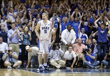 Duke's Mason Plumlee celebrates following a basket against North Carolina State during the second half of an NCAA college basketball game in Durham, N.C., Thursday, Feb. 16, 2012. Duke won 78-73. (AP Photo/Gerry Broome)