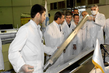 This photo released by the Iranian President's Office, claims to show Iranian President Mahmoud Ahmadinejad, second left being escorted by technicians during a tour of Tehran's research reactor centre in northern Tehran, Iran, Wednesday Feb. 15, 2012. In defiant swipes at its foes, Iran said Wednesday it is dramatically closer to mastering the production of nuclear fuel even as the U.S. weighs tougher pressures and Tehran's suspected shadow war with Israel brings probes far beyond the Middle East. (AP Photo/Iranian President's Office)