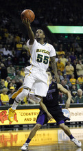 Baylor's Pierce Jackson (55) shots past Kansas State's Angel Rodriguez (13) during the first half of an NCAA college basketball game, Saturday Feb. 18, 2012, in Waco, Texas. (AP Photo/LM Otero)