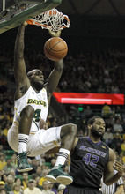 Baylor's Quincy Acy (4) scores against Kansas State's Thomas Gipson (42) during the first half of an NCAA college basketball game, Saturday Feb. 18, 2012, in Waco, Texas. (AP Photo/LM Otero)