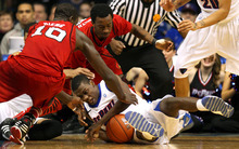 Louisville's Gorgui Dieng, left, DePaul's Donnavan Kirk, center, and Louisville's Russ Smith, back, fight for the loose ball during the first half of an NCAA college basketball game in Rosemont, Ill., on Saturday, Feb. 18, 2012.  (AP Photo/Kamil Krzaczynski)
