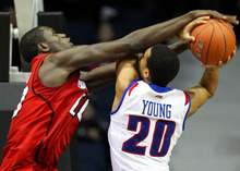DePaul's Brandon Young, right, is fouled on the way to the basket by Louisville's Gorgui Dieng, left, during the first half of an NCAA college basketball game in Rosemont, Ill., on Saturday, Feb. 18, 2012.  (AP Photo/Kamil Krzaczynski)