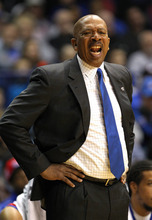 DePaul head coach Oliver Purnell directs his players during the first half of an NCAA college basketball game against Louisville in Rosemont, Ill., on Saturday, Feb. 18, 2012.  (AP Photo/Kamil Krzaczynski)