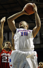DePaul's Derrell Robertson Jr, right, goes to the basket in front of Louisville's Jared Swopshire, left, during the first half of an NCAA college basketball game in Rosemont, Ill., on Saturday, Feb. 18, 2012.  (AP Photo/Kamil Krzaczynski)