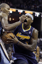 Denver Nuggets forward Al Harrington (7) collides with Memphis Grizzlies center Marreese Speights during the first half of an NBA basketball game in Memphis, Tenn., Friday, Feb. 17, 2012. (AP Photo/Danny Johnston)