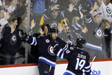 Winnipeg Jets' Blake Wheeler (26) celebrates with Jim Slater (19) after scoring against the Boston Bruins during the second period of an NHL hockey game, Friday, Feb. 17, 2012, in Winnipeg, Manitoba. (AP Photo/The Canadian Press, Trevor Hagan)