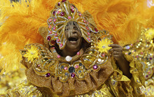 A dancer performs during the Carnival parade of Camisa Verde e Branco samba school in Sao Paulo, Brazil, Saturday, Feb. 18, 2012. (AP Photo/Andre Penner)