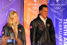 Rick Egan  | The Salt Lake Tribune    Ann and Mitt Romney smile as they take the stage before he speaking to a group of former SLOC members in the Grande Hall at the Gateway Center, Saturday, February 18, 2012.