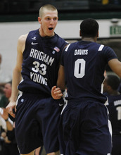 BYU's Nate Austin (33) and Brandon Davies celebrate after BYU beat San Francisco 85-84 in an NCAA college basketball game in San Francisco, Thursday, Feb. 16, 2012. (AP Photo/George Nikitin)