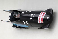USA's Steven Holcomb pilots with brakeman Steven Langton as they compete in the third heat in the men's two-man bobsled world championships in Lake Placid, N.Y., on Sunday, Feb. 19, 2012. (AP Photo/Mike Groll)