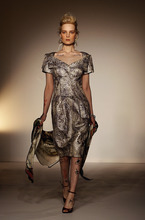 A model displays a creation by designer Vivienne Westwood during a fashion show at London Fashion Week, Sunday, Feb. 19, 2012. (AP Photo/Kirsty Wigglesworth)