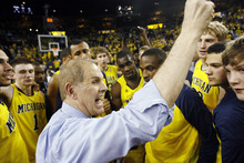 Michigan head coach John Beilein celebrates with his team after defeating Ohio State 56-51 in an NCAA college basketball game, Saturday, Feb. 18, 2012, in Ann Arbor, Mich. (AP Photo/Tony Ding)