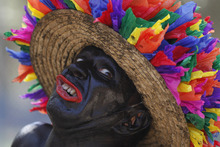 A reveler makes a face during carnival in Barranquilla, Colombia, Saturday Feb. 18, 2012.  In 2003 the UNESCO declared Barranquilla's carnival a