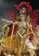 A dancer from the Dragoes da Real samba school performs on a float during a carnival parade in Sao Paulo, Brazil, Saturday Feb. 18, 2012. Carnival runs Feb. 17-21. (AP Photo/Andre Penner)