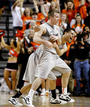 Oklahoma State's Keiton Page, center, and Cezar Guerrero, right, celebrate after Page scored against Texas during an NCAA college basketball game, Saturday, Feb. 18, 2012, in Stillwater, Okla. Page contributed 40 points as Oklahoma State won 90-78. (AP Photo/The Oklahoman, Bryan Terry) TABLOIDS OUT