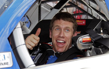 Terry Renna | The Associated Press Carl Edwards gives a thumbs-up in his car after his qualifying run for the NASCAR Daytona 500 auto race at Daytona International Speedway, Sunday, Feb. 19, 2012, in Daytona Beach, Fla. Edwards won the pole (AP Photo/Terry Renna)