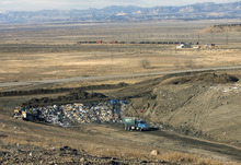 Al Hartmann  |  The Salt Lake Tribune Garbage truck with municipal waste dumps its garbage in a tiny area the massive landfill near East Carbon.   ECDC Environmental wants to be permitted to bury PCB waste in a small section in of one of the super cells at the landfill.