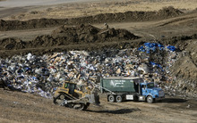 Al Hartmann  |  The Salt Lake Tribune Garbage truck with municipal waste dumps its garbage in a tiny portion in the massive landfill near East Carbon.   ECDC Environmental wants to be permitted to bury PCB waste in a small section in of one of the super cells at the landfill.