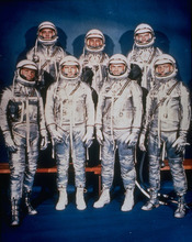 FILE - This 1961 file photo provided by NASA shows the original seven Mercury astronauts in their silver spacesuits. First row, from left are Walter Schirra Jr., Donald Slayton, John Glenn and Scott Carpenter. In the back row are Alan Shepard, Jr., Virgil Grissom and Gordon Cooper. (AP Photo/NASA, File)
