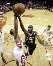 Houston Rockets' Gregory Smith, left, blocks the shot of Utah Jazz's Al Jefferson (25) during the first half of an NBA basketball game, Sunday, Feb. 19, 2012, in Houston. (AP Photo/David J. Phillip)